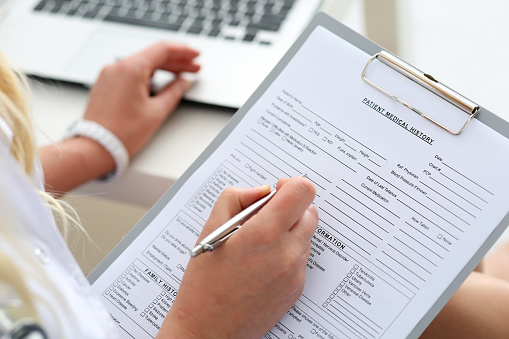 Woman filling out patient form